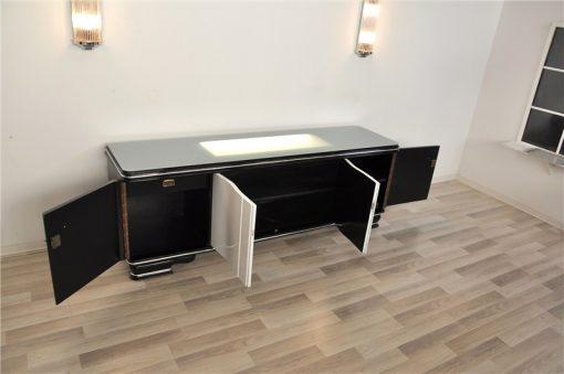 Art Deco Lowboard, Hochglanzschwarz und Hochglanzweiß, Schiebetüren, elegantes Design, absoluter Eyecatcher